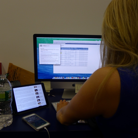 Hayley Milon editing the script for that night's episode of American Express Home Court Advantage pre-game show